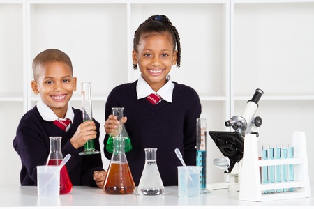 schoolboys: elementary school students in science lab