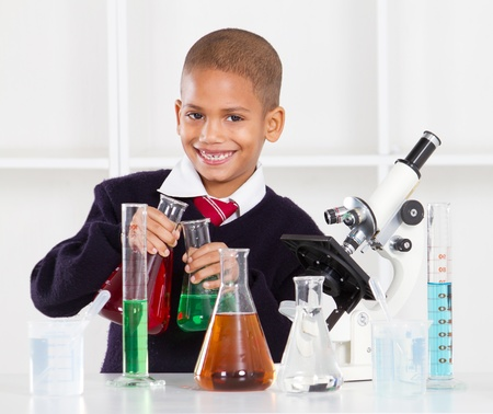 happy primary schoolboy in science lab photo