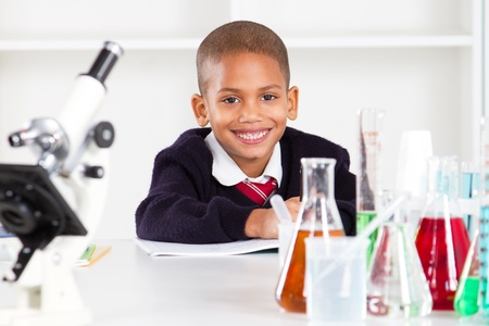 science lab: happy primary schoolboy in science lab