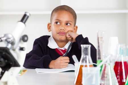 thoughtful science boy in lab photo
