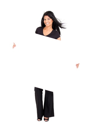 young cheerful indian woman holding white board photo