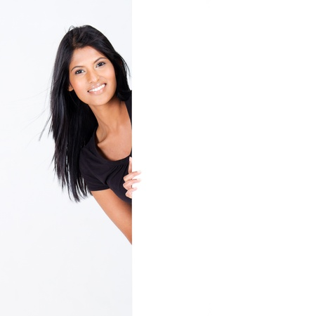 attractive hispanic woman behind blank white board photo