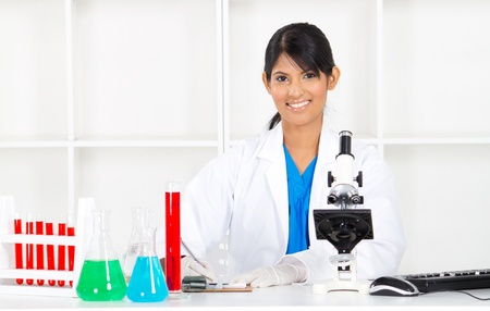 pretty indian female science researcher in lab photo