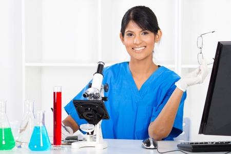 examiner: pretty indian female science researcher in lab Stock Photo