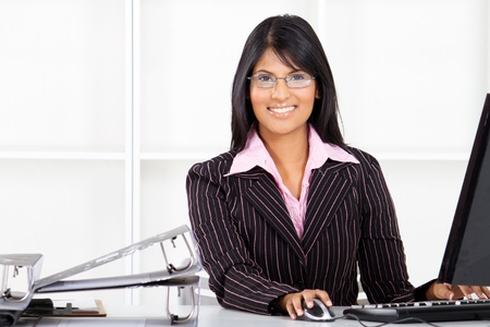 neat: beautiful young indian businesswoman in office
