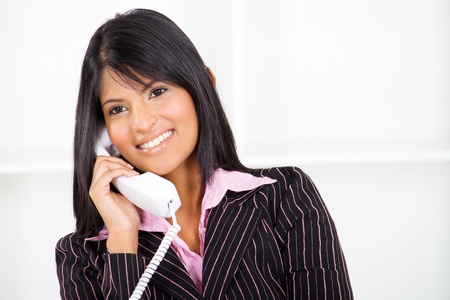 answering call: beautiful businesswoman on the phone Stock Photo