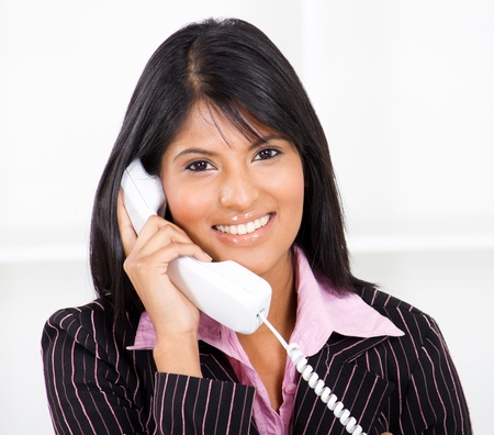 answering phone: friendly receptionist on the phone