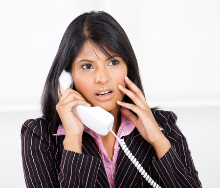 frustration girl: young businesswoman shocked by phone call Stock Photo