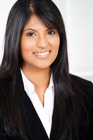 smart young hispanic businesswoman closeup portrait photo