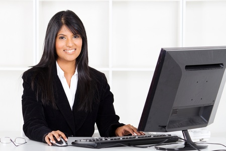 beautiful young indian businesswoman in office Stock Photo