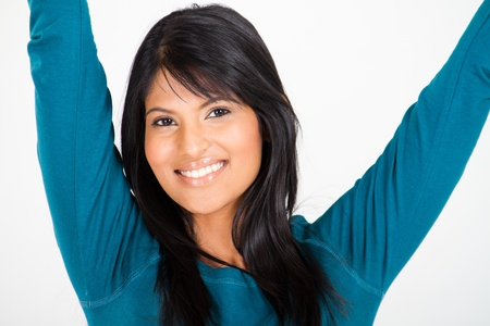 cheerful young woman arms up photo