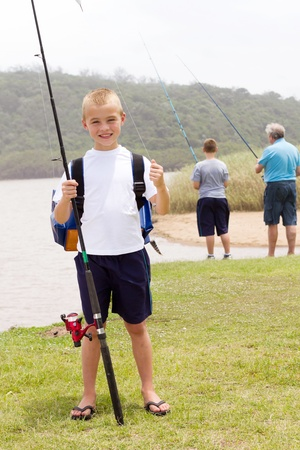 children pond: happy little boy fishing with grandpa and brother Stock Photo