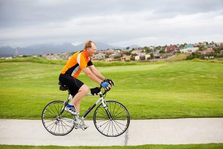active senior man riding a bicycle photo