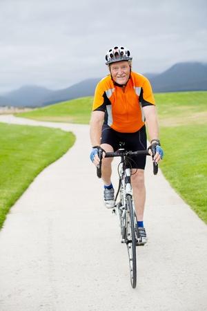 active senior man riding a road bicycle photo