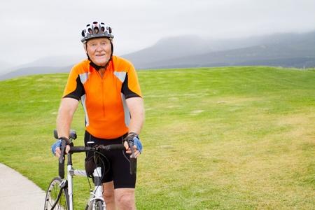 active senior male bicyclist portrait outdoors photo