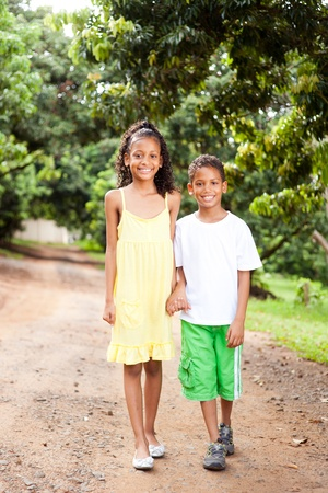happy little brother and sister walking outdoors photo