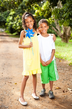happy young sister and brother outdoors together  photo
