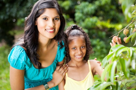 daugther: beautiful young mother and daughter in litchi orchard