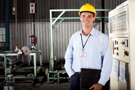 technical department: happy male technician in factory Stock Photo