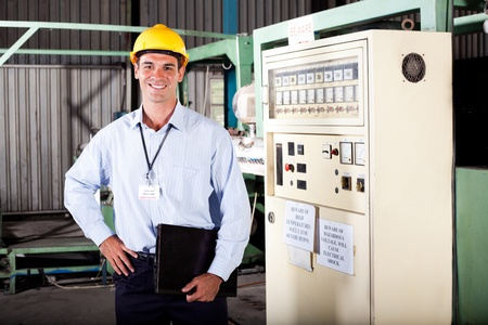 technical department: male industiral engineer portrait in factory Stock Photo