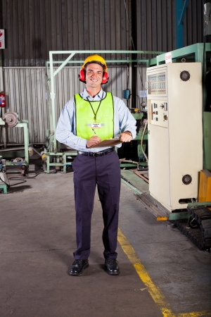 health and safety: male occupational safety inspector inside factory