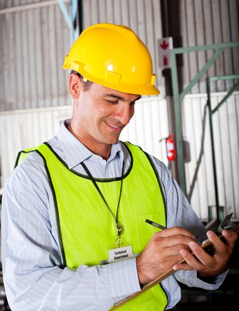 technical department: male caucasian technician working in factory