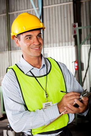 male caucasian technician taking machine gauge reading photo