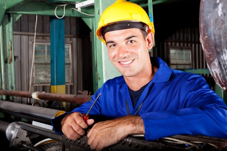 happy male industrial mechanic at work photo