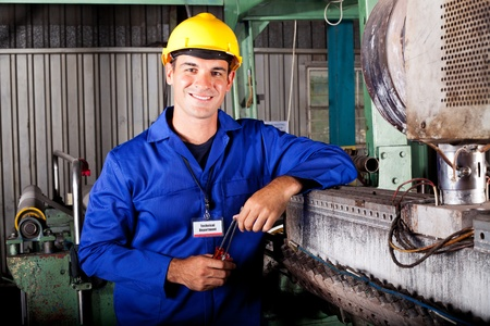 overall: industrial mechanical technician portrait in factory