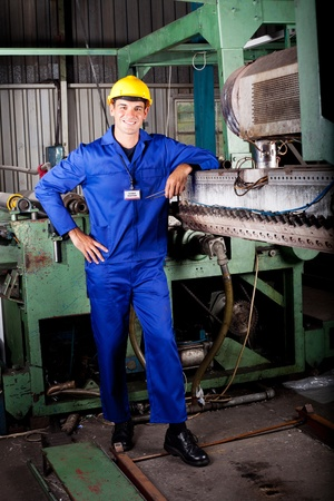 heavy industry mechanic portrait in factory photo