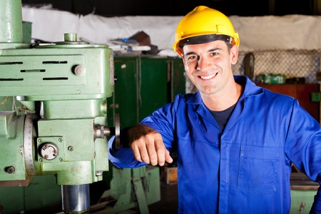 happy industrial artisan portrait in workshop Stock Photo - 12431880