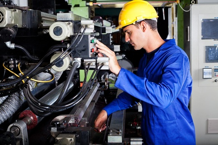 printing press: male caucasian operator operating industrial printing press Stock Photo