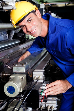 skilled: happy modern industrial machine operator at work Stock Photo