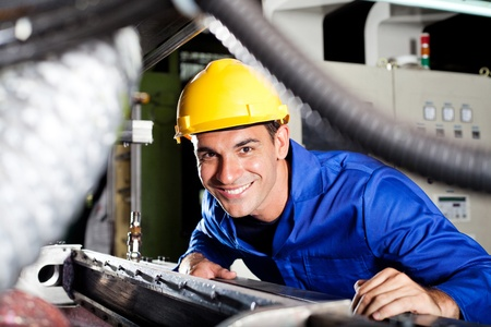 craftsperson: happy modern blue collar worker in factory Stock Photo