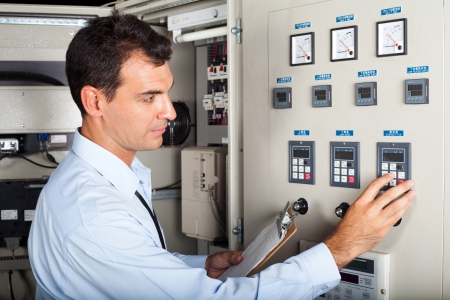 professional industrial engineer adjusting modern machine settings photo