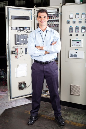 full length portrait of modern factory technical worker photo