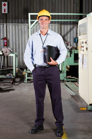 full length portrait of factory technical manager photo