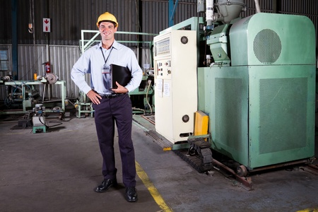 technical department: full length portrait of a factory manager