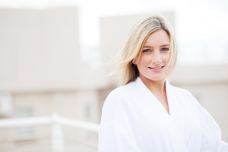 young woman in bathrobe in the morning Stock Photo - 12725781