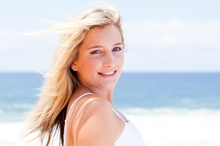 stress free: cheerful young woman over sea view background Stock Photo