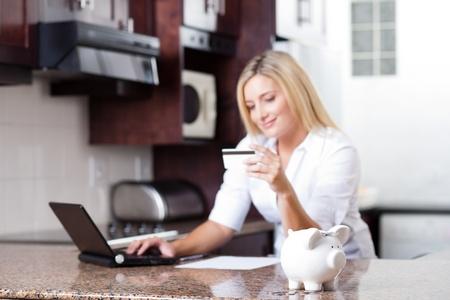 pretty young woman financial savings, focus on piggybank photo