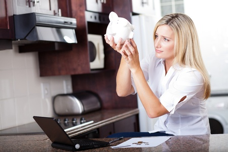 unhappy woman has no more money left to pay bills photo