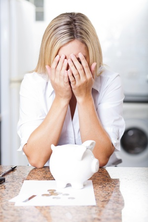 unhappy young woman having financial trouble photo