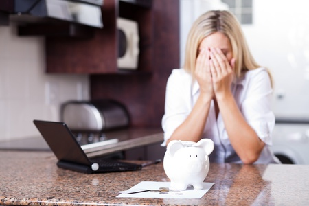 crying young woman having financial problems photo