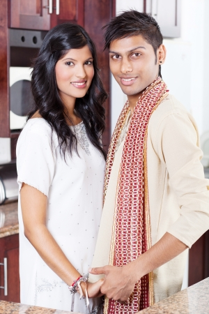 happy young indian couple portrait in traditional clothing photo