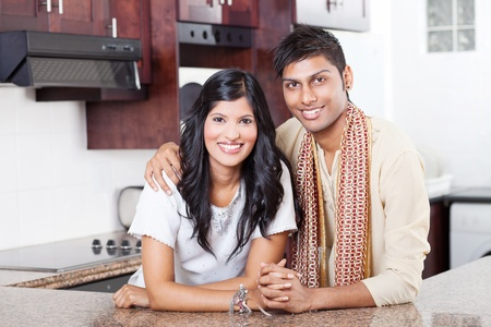 beautiful young indian couple portrait at home photo
