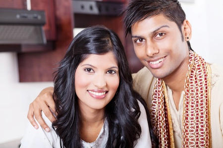 ethnic attire: closeup portrait of beautiful young indian couple