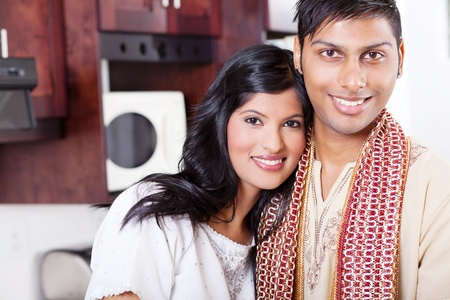 ethnic attire: closeup portrait of young indian couple hugging