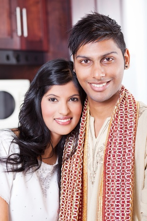 indian traditional: beautiful young indian couple portrait in traditional clothing