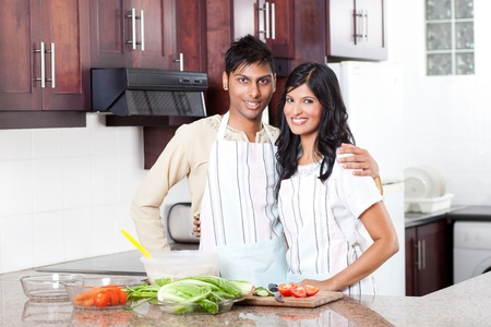 indian couple: happy young indian couple portrait in kitchen